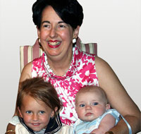Louise Batz holding 2 children